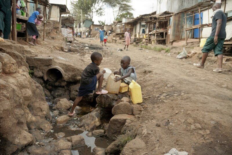 poor children collecting water